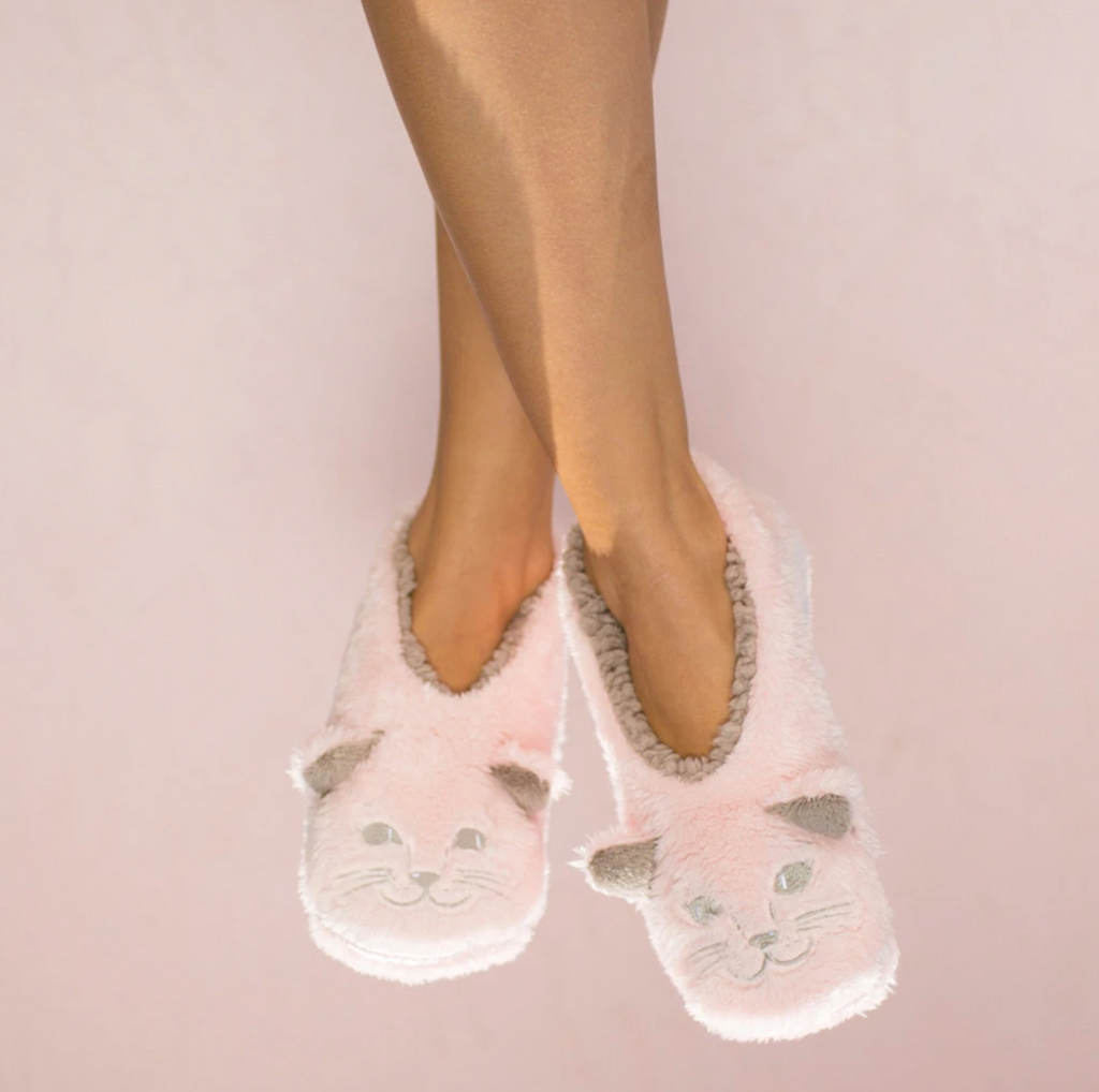 Faceplant cat naps slippers from Diament Jewelry, a gift shop in Washington, DC.