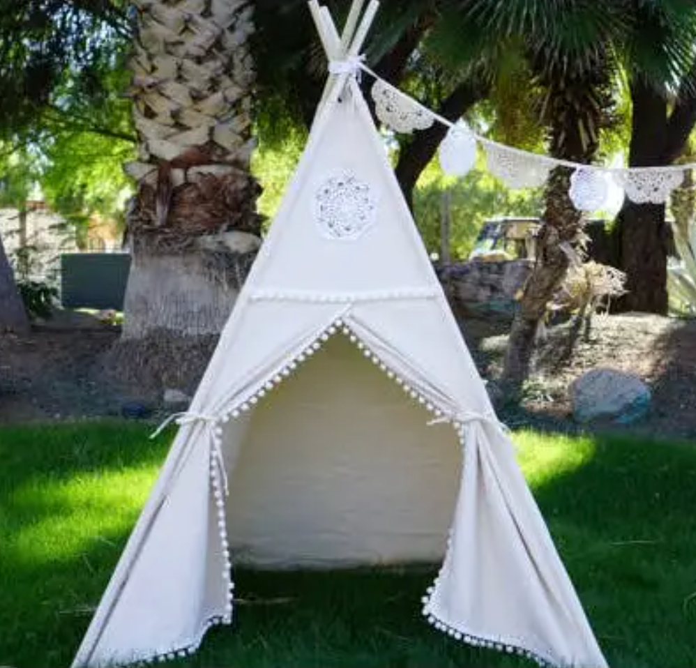 White Teepee With Mat from Diament Jewelry, a gift shop in Washington, DC.