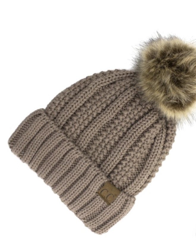 Tan Lined Cable Pom Beanie from Diament Jewelry, a gift shop in Washington, DC.