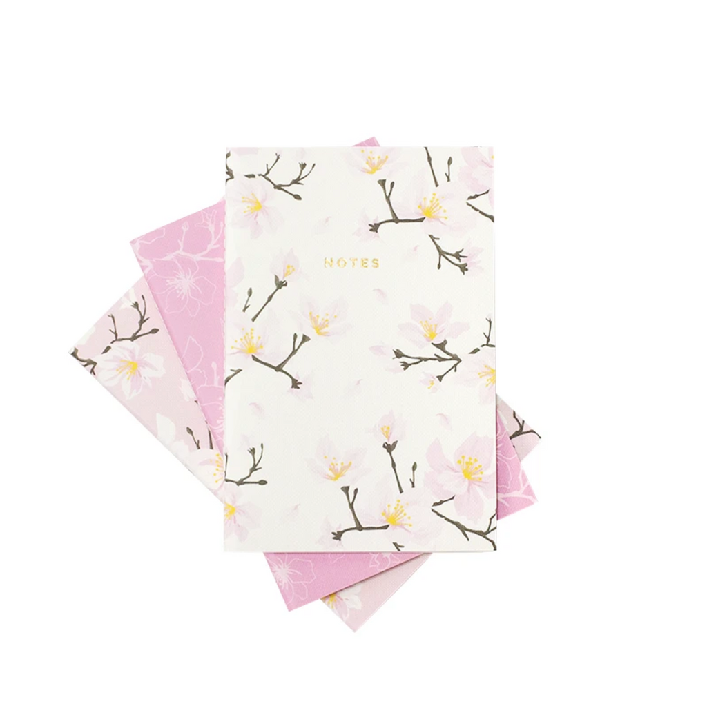 Mini Cherry Blossom Pattern Notebooks from Diament Jewelry, a gift shop in Washington, DC.