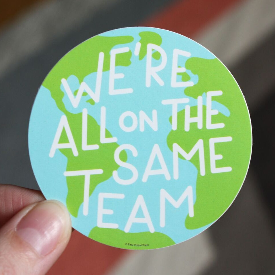 We're All on the Same Team Sticker from Diament Jewelry, a gift shop in Washington, DC.