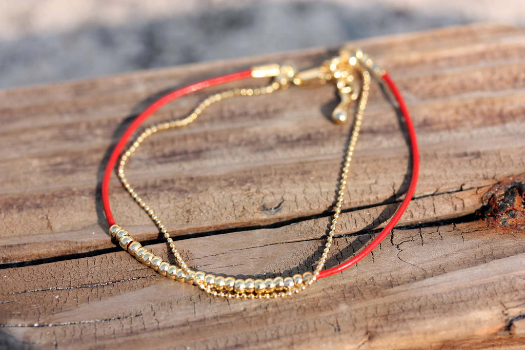Dainty beaded red and gold bracelet from Diament Jewelry, a gift shop in Washington, DC.
