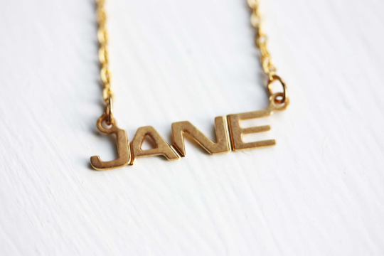 Vintage Jane gold name necklace from Diament Jewelry, a gift shop in Washington, DC.