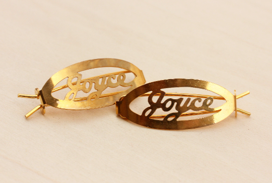 Vintage Joyce gold hair clips from Diament Jewelry, a gift shop in Washington, DC.