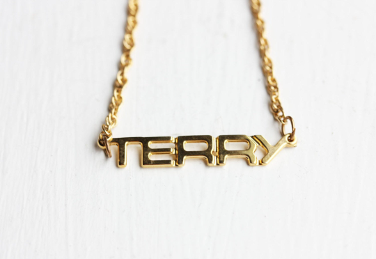 Vintage Terry gold name necklace from Diament Jewelry, a gift shop in Washington, DC.