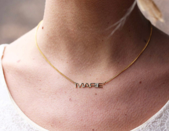 Vintage Marie gold name necklace from Diament Jewelry, a gift shop in Washington, DC.