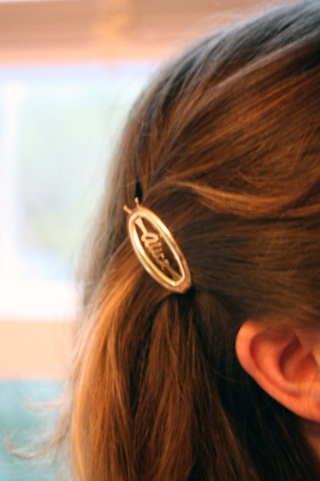 Vintage Alice gold hair clips from Diament Jewelry, a gift shop in Washington, DC.