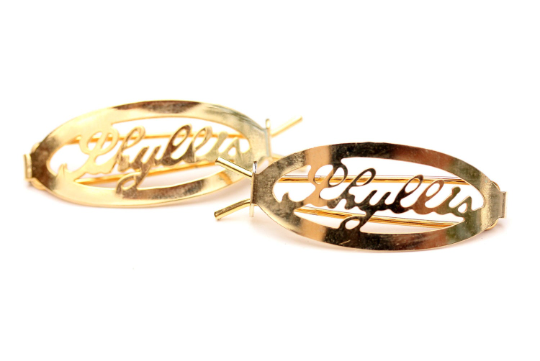 Vintage Phyllis gold hair clips from Diament Jewelry, a gift shop in Washington, DC.