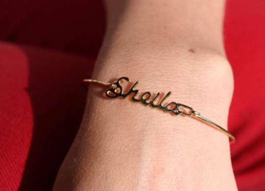 Vintage Sheila gold name bracelet from Diament Jewelry, a gift shop in Washington, DC.