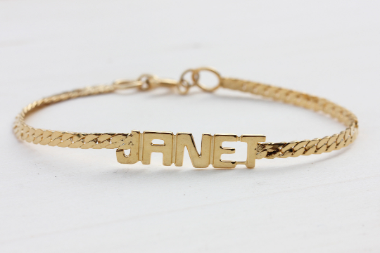 Vintage Janet gold name bracelet from Diament Jewelry, a gift shop in Washington, DC.