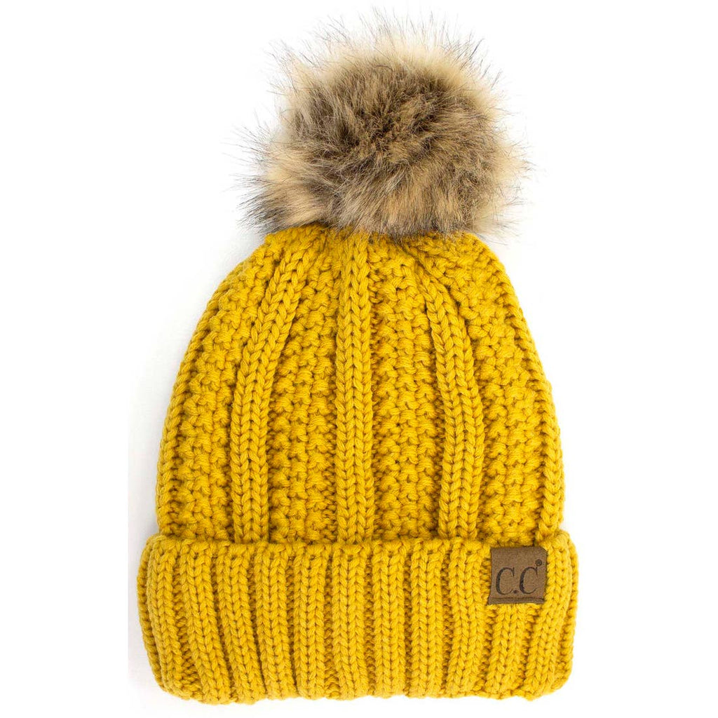 Yellow Lined Cable Pom Beanie from Diament Jewelry, a gift shop in Washington, DC.