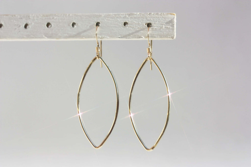 Gold oval wire dangle earrings from Diament Jewelry, a gift shop in Washington, DC.
