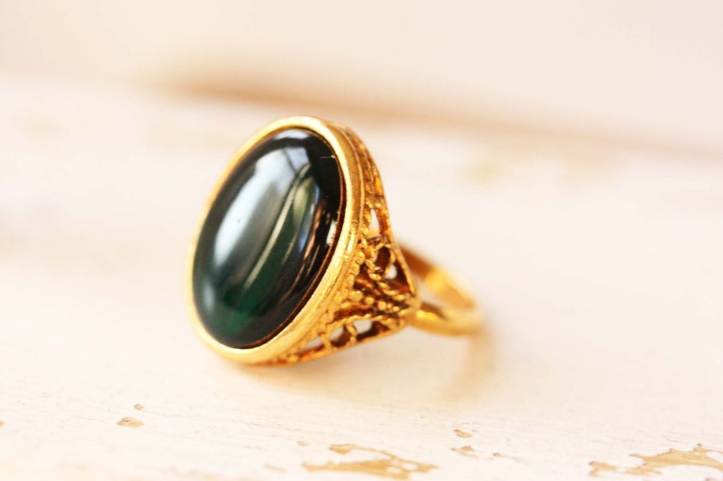 Green Resin Ring from Diament Jewelry, a gift shop in Washington, DC.