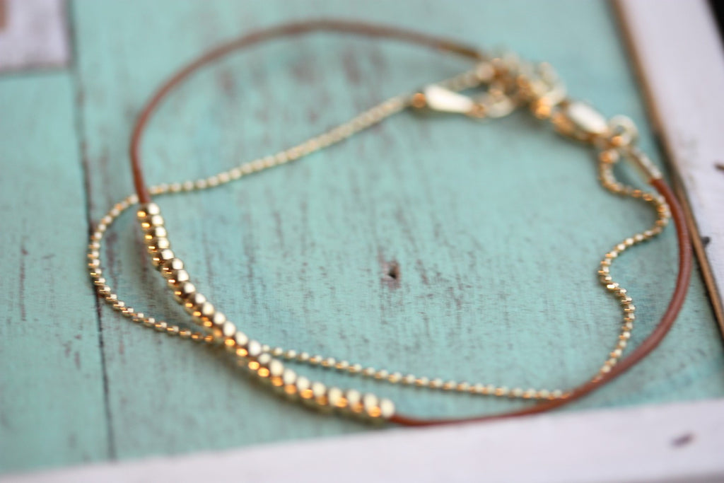 Dainty beaded brown and gold bracelet from Diament Jewelry, a gift shop in Washington, DC.