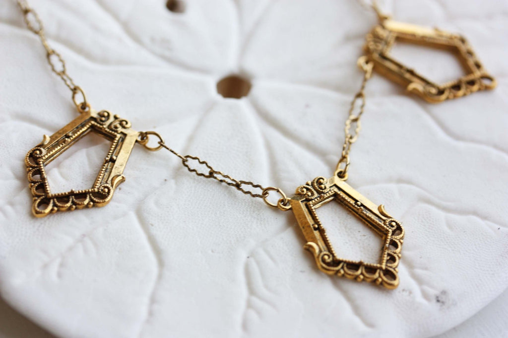 Vintage gold chain trapezoid necklace from Diament Jewelry, a gift shop in Washington, DC.
