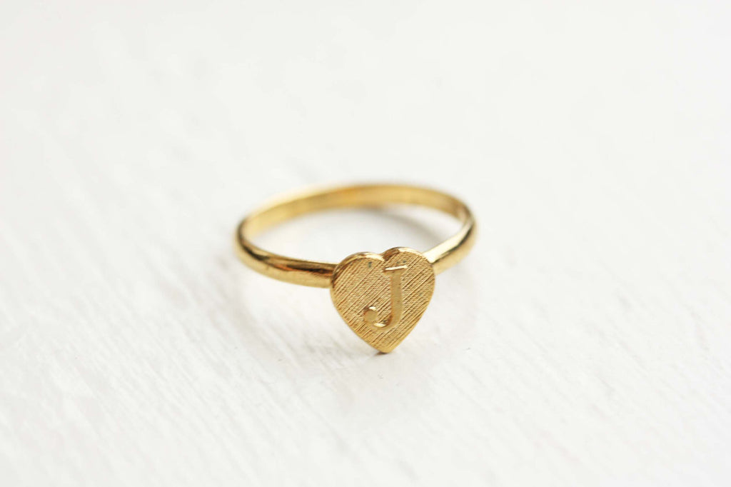 Vintage adjustable gold initial ring from Diament Jewelry, a gift shop in Washington, DC.