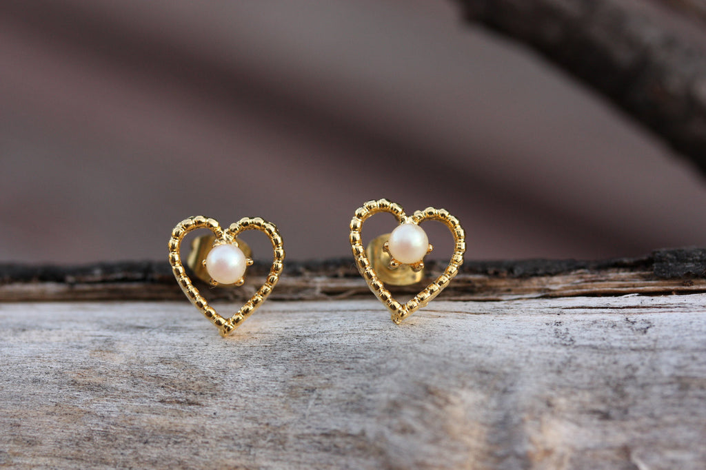 Gold heart and pearl wire studs from Diament Jewelry, a gift shop in Washington, DC.