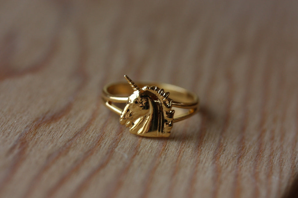 Vintage small gold unicorn ring from Diament Jewelry, a gift shop in Washington, DC.