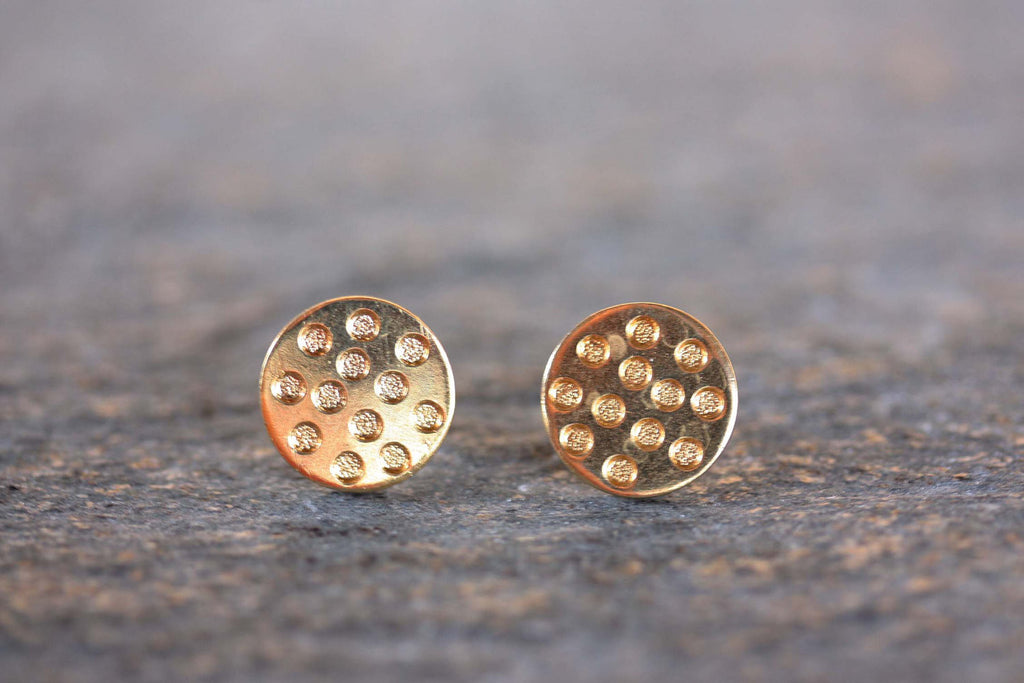 Gold Polka Dot Studs from Diament Jewelry, a gift shop in Washington, DC.