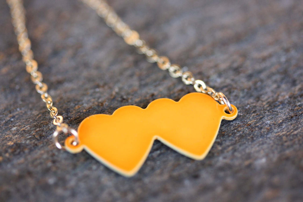 Neon double heart charm necklace from Diament Jewelry, a gift shop in Washington, DC.