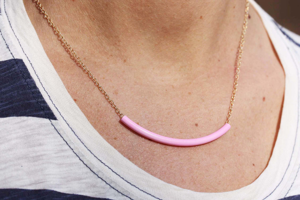 Pink tube gold chain necklace from Diament Jewelry, a gift shop in Washington, DC.