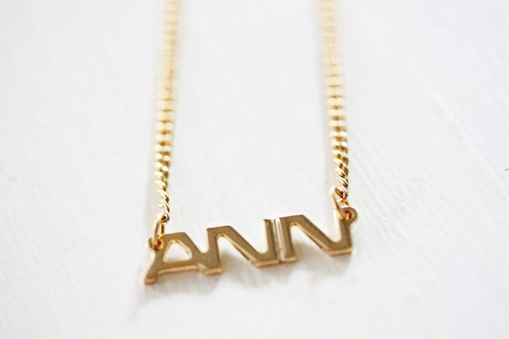Vintage Ann gold name necklace from Diament Jewelry, a gift shop in Washington, DC.