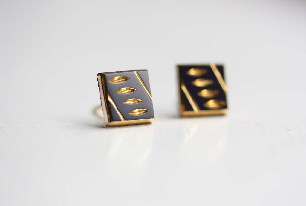 Black and gold dash studs from Diament Jewelry, a gift shop in Washington, DC.