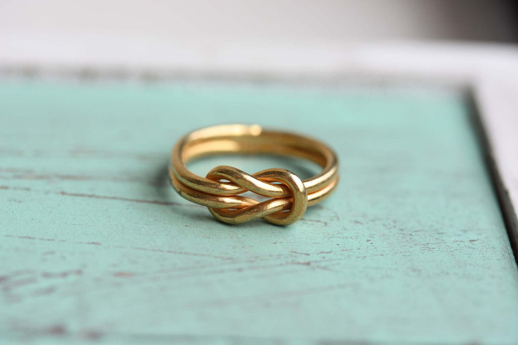 Vintage gold double sailor knot ring from Diament Jewelry, a gift shop in Washington, DC.