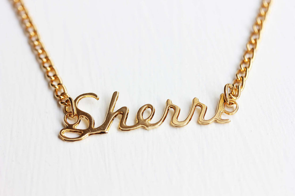 Vintage Sherri gold name necklace from Diament Jewelry, a gift shop in Washington, DC.
