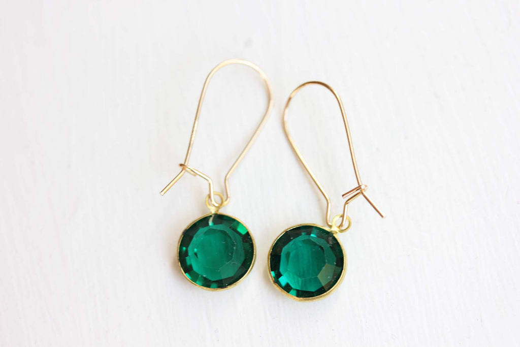 Vintage green swarovski crystal dangle earrings from Diament Jewelry, a gift shop in Washington, DC.