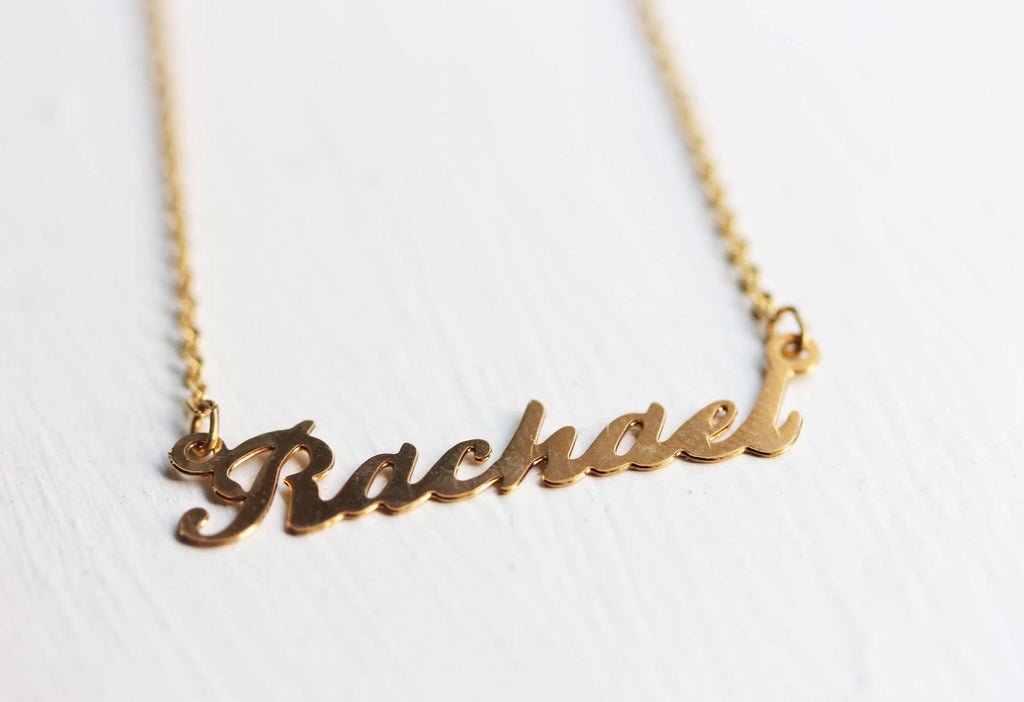 Vintage Rachael gold name necklace from Diament Jewelry, a gift shop in Washington, DC.