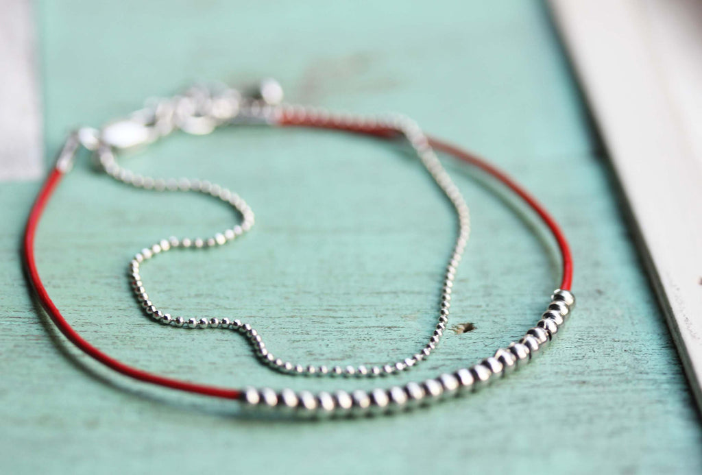 Dainty beaded red and silver bracelet from Diament Jewelry, a gift shop in Washington, DC.