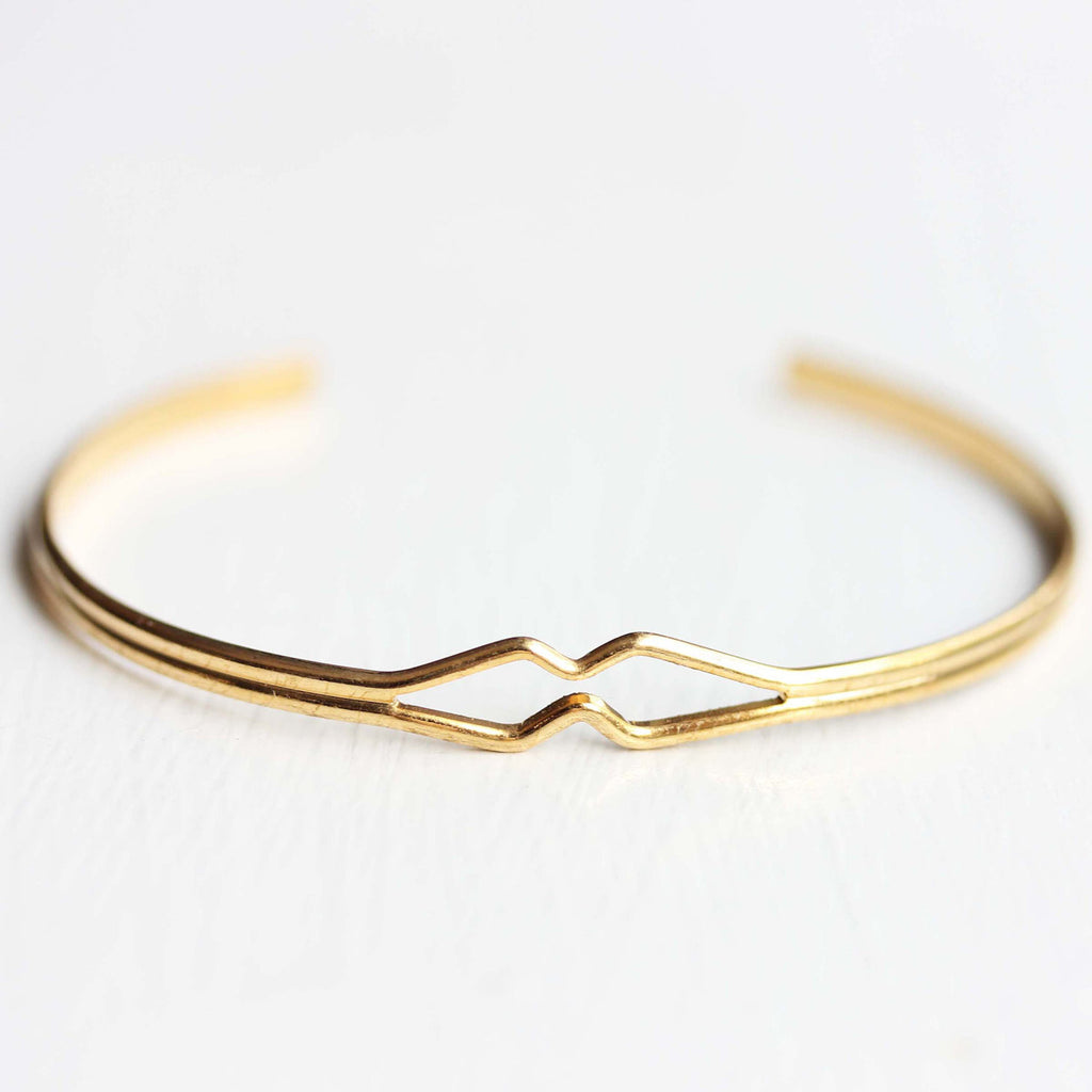 Vintage gold wire diamond shaped adjustable cuff bracelet from Diament Jewelry, a gift shop in Washington, DC.
