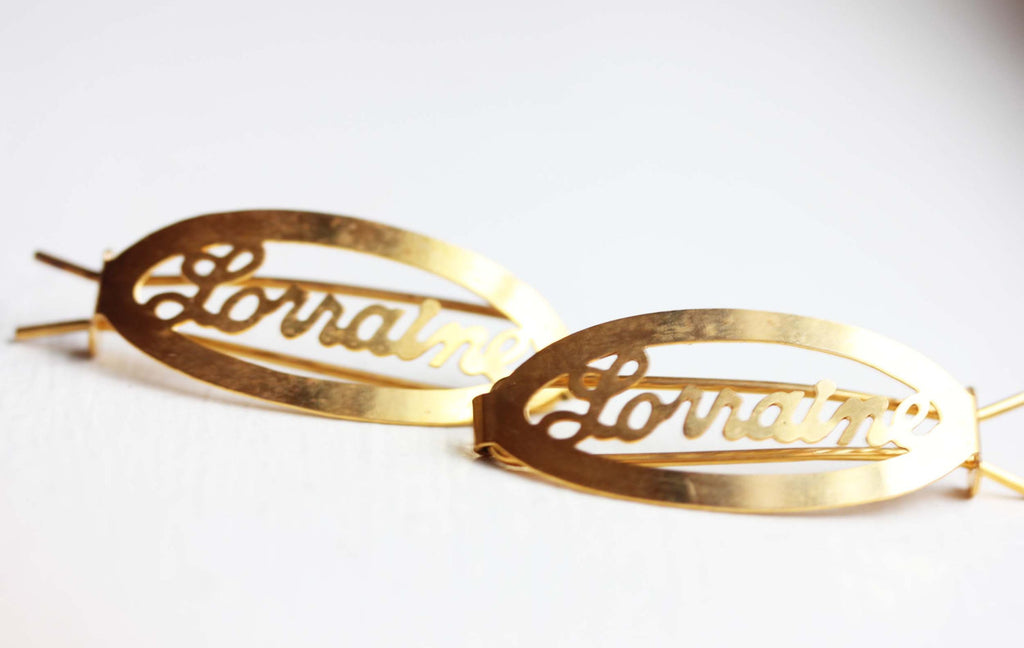 Vintage Lorraine gold hair clips from Diament Jewelry, a gift shop in Washington, DC.