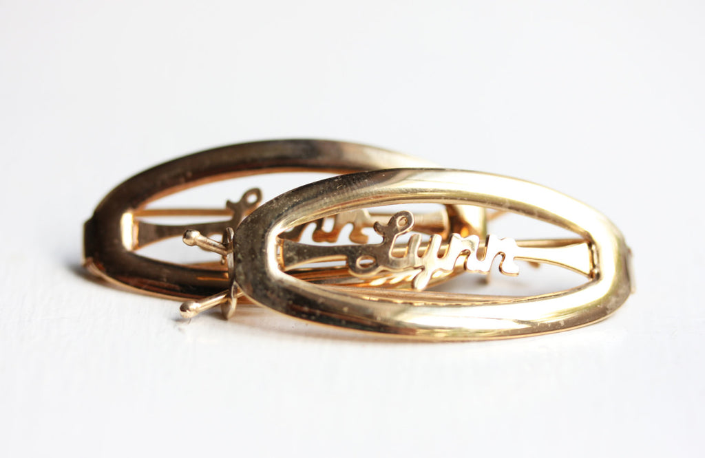 Vintage Lynn gold hair clips from Diament Jewelry, a gift shop in Washington, DC.