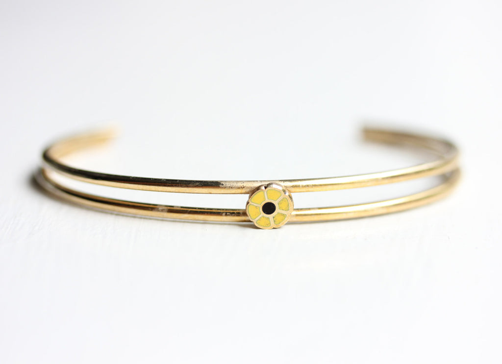 Yellow daisy cuff bracelet from Diament Jewelry, a gift shop in Washington, DC.