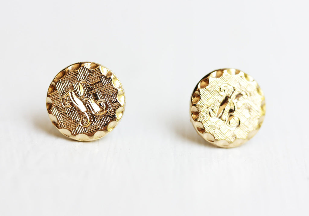 Textured K initial gold dot studs from Diament Jewelry, a gift shop in Washington, DC.