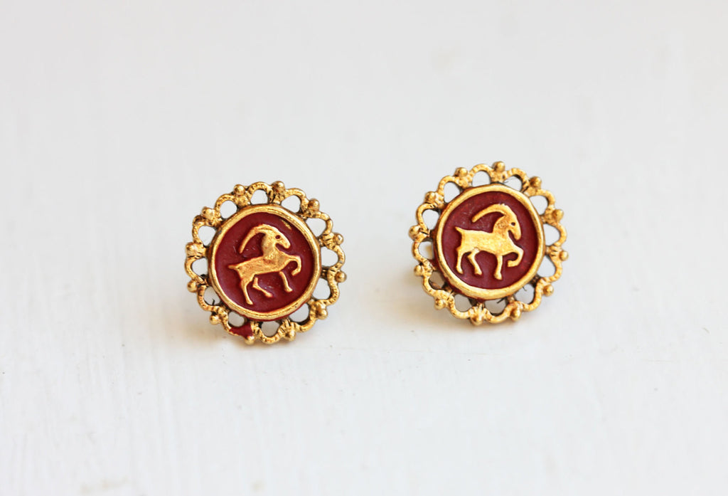 Enamel filigree Capricorn zodiac studs from Diament Jewelry, a gift shop in Washington, DC.