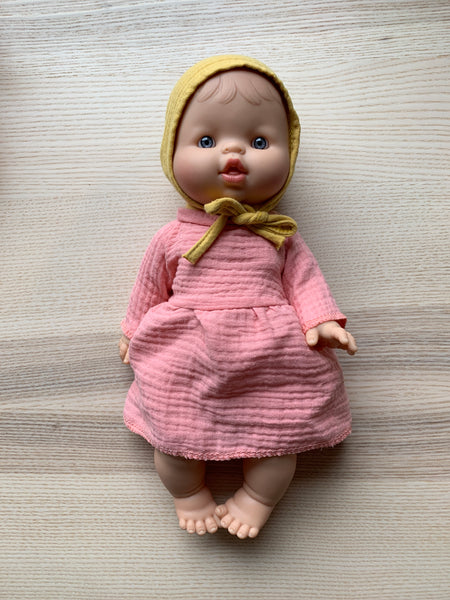 Minikane White Girl Doll with Pink Dress and Bonnet