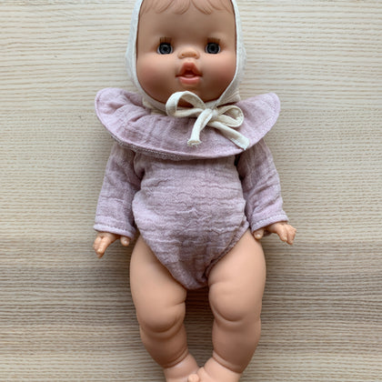 Minikane White Baby Doll with Cream Bonnet and Pink Romper