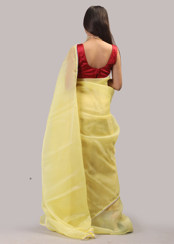 Yellow organza with pearl border saree
