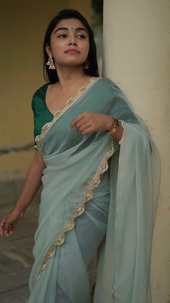 Powder Blue Organza Saree with pearl embellished border
