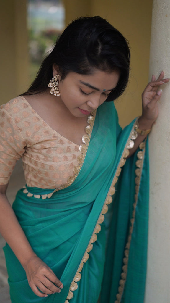 Royal Chiffon Teal Saree with gold border