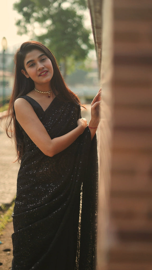 Sequinned Embroidered Black Georgette Saree.