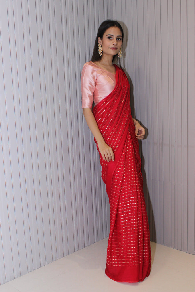 Red chinnon saree with embellishments