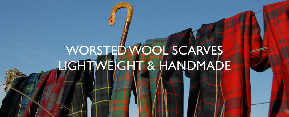 Six worsted wool scarves on a fence in Wester Ross, Scotland.
