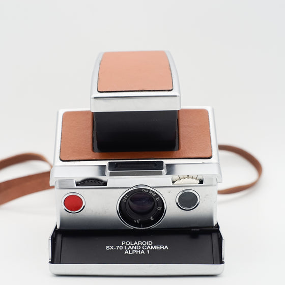 Polaroid SX-70 Land Camera Alpha 1 SLR instant camera with leather strap