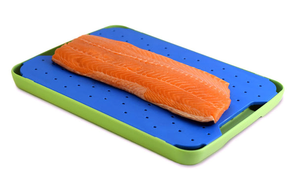 Salmon shown on the blue seafood FLOW cutting board