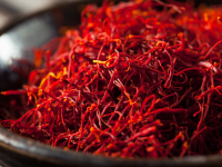 bright orange red saffron threads piled in a bowl