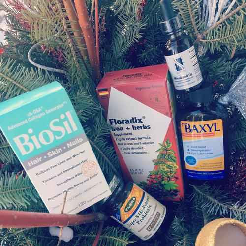 Biosil, Floradix, Baxyl, Probiotica, and vitamin D in a holiday floral arrangement